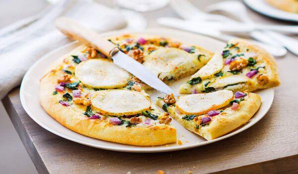 Pizza chèvre, miel, noix